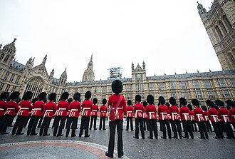 State Opening of Parliament - The 1st Battalion, Irish Guards accompanied by the Band of the Irish Guards provide a Guard of Honour at the House of Lords for the State Opening of Parliament in 2016.