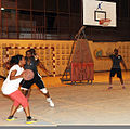 A Djiboutian player prepares to pass the ball during a basketball game against U.S. Service members with Combined Joint Task Force-Horn of Africa and Camp Lemonnier in Djibouti July 16, 2013 130716-N-QY430-324.jpg