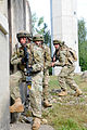 A Georgian soldier with the 32nd Infantry Battalion kicks in a door during a mission rehearsal exercise at the Joint Multinational Readiness Center in Hohenfels, Germany, Aug. 5, 2012 120805-A-GG082-006.jpg