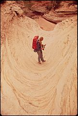 A Hiker in the Maze, a Remote and Rugged Region in the Heart of the Canyonlands, 05-1972 (3814974920).jpg