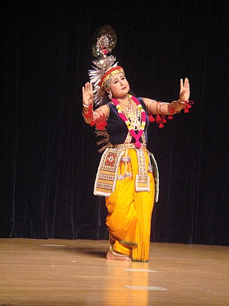 Dhoti - Female dancer dressed as Krishna in yellow dhoti
