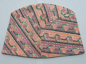 A Typical Nepali Dhaka Topi laid on a level surface.jpg