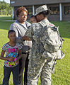 A U.S. Soldier with the 310th Human Resources Sustainment Center (HRSC), kisses her child just before departing to Fort Dix, N.J. for mobilization training, at Fort Jackson, S.C., June 20, 2013 130620-A-IL912-046.jpg
