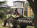 A farm tracker driver heading to plow farmer land.jpg