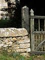 A gate and wall at Church of Saint Nicholas, Walcot, Lincolnshire, England.jpg