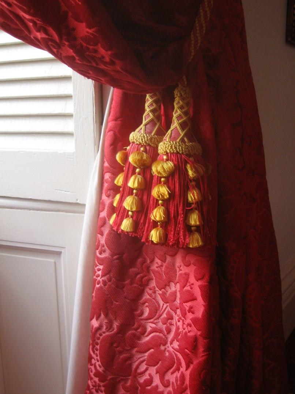 A handmade tassel on drapery