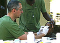 A medical doctor with the Spanish Marines renders medical aid to a Haitian Boy DVIDS254507.jpg