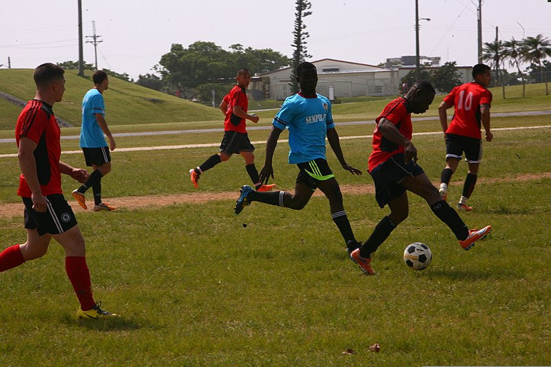 File:A player from Chivas M.C. dribbles a soccer ball as part of a ...