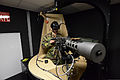 A soldier with the Royal Netherlands Army sits on the gunner station while training in the Training Support Activity Europe's Virtual Clearance Training Suite as part of the European Union's Battle group 140221-A-FS311-062.jpg