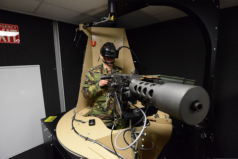 A soldier with the Royal Netherlands Army sits on the gunner station while training in the Training Support Activity Europe%27s Virtual Clearance Training Suite as part of the European Union%27s Battle group 140221-A-FS311-062.jpg