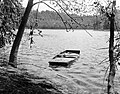 A typical scene along the Potomac River as it parallels the historic Old Canal route a half sunken rowboat tied to the shore (efa5799c2e8143de812a99858570d78b).jpg