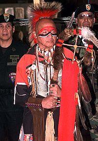 An Abenaki Indian man in traditional clothing.