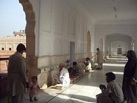 People washing before prayer at the Badshahi mosque in Lahore, Pakistan