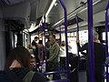 Aboard airport terminal shuttle bus (28157771128).jpg