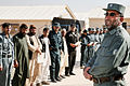 Afghan National Police (ANP) Lt. Col. Hajib Delaga, right, the commander of the ANP provincial training center, speaks to graduating recruits during a ceremony at the center in Tirin Kot, Uruzgan province 131114-O-ZZ999-256-AU.jpg