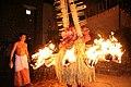 Agnigulikan Theyyam Performer on Fire.jpg