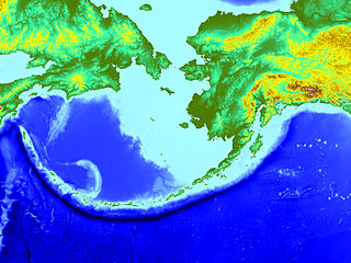 Aleutian subduction zone Convergence boundary between the North American Plate and the Pacific Plate, that extends from the Alaska Range to the Kamchatka Peninsula.
