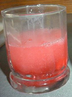 Cherry Alka Seltzer Plus Tablet dissolving in water