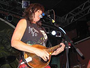 Cultural impact of Elvis Presley - Folk rock musician Amy Ray wearing an Elvis shirt onstage