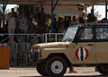 An Iraqi army officer stands at attention in his vehicle while performing a pass and review during a change of command ceremony on Camp Taji, Iraq.jpg