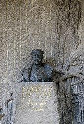 Eine Büste von Ladislav Šaloun schmückt Dvořáks Grab auf dem Vyšehrader Friedhof (Quelle: Wikimedia)