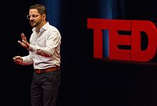 Ari Wallach speaking at TEDx MidAtlantic.jpg