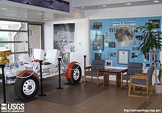 Astrogeology Research Program - Displays in the entryway of the USGS Shoemaker Building, featuring Grover, a version of the lunar rovers used to train astronauts in Flagstaff, Arizona.