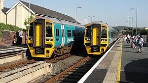 Tywyn railway station - Two Class 158s pass at Tywyn station, Wales 21/08/2013
