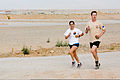 Australian Army Capts. George Minns, right, and Julia Nikolic participate in the Sand to Sand charity run at Multinational Base Tarin Kowt, Uruzgan province, Afghanistan, Aug. 17, 2013 130817-O-MD709-257-AU.jpg