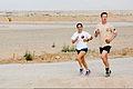 Australian Army Capts. George Minns, right, and Julia Nikolic participate in the Sand to Sand charity run at Multinational Base Tarin Kowt, Uruzgan province, Afghanistan, Aug. 17, 2013 130817-O-MD709-257-AU.jpg