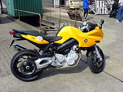 Yellow BMW F800S parked on concrete