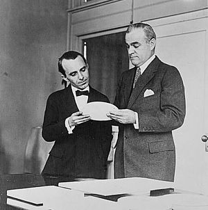 Peace dollar - Sculptor Anthony de Francisci (left) and Mint Director Raymond T. Baker (right) inspecting a plaster model of the new silver dollar