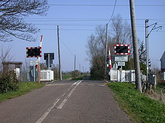 Level crossings in the United Kingdom - A half-barrier level crossing known as an AHBC near Waterbeach, Cambridgeshire