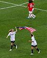 Becky Sauerbrunn Christie Rampone American flag.jpg
