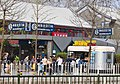 Beigongmen subway station entrance and food cart, Beijing.jpg