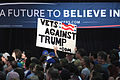 Bernie Sanders supporter with anti-Donald Trump sign (25341308394).jpg