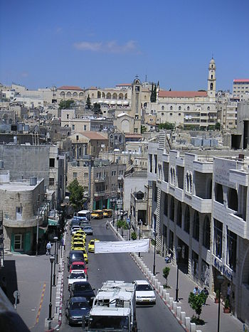 A street in Bethlehem lined with taxis