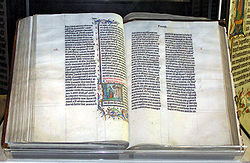 A Bible handwritten in Latin, on display in Malmesbury Abbey, Wiltshire, England. This Bible was transcribed in Belgium in 1407 for reading aloud in a monastery.