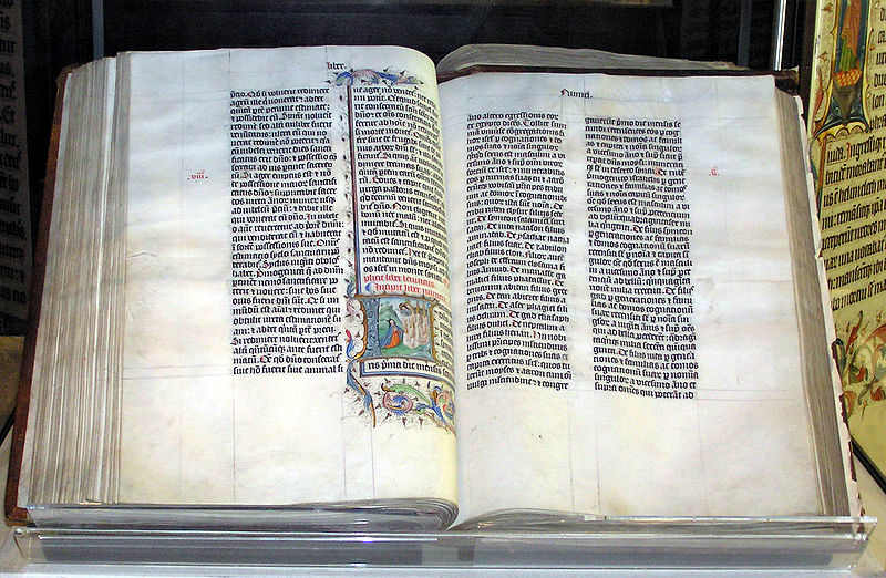 Bible handwritten in Latin, on display in Malmesbury Abbey, Wiltshire, England. The Bible was written in Belgium in 1407 AD, for reading aloud in a monastery.