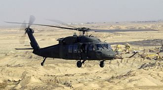 Sikorsky UH-60 Black Hawk - A UH-60L Black Hawk flies a low-level mission over Iraq in January 2004.