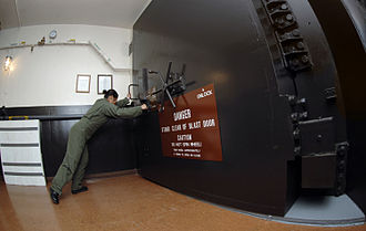 91st Missile Wing - A missile crew member closing the blast door at Missile Alert Facility B-1, Minot AFB