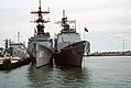 Bow view of USS Spruance (DD-963) and USS Ticonderoga (CG-47) at Naval Station Norfolk on 8 October 1983 (6397938).jpg