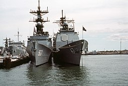 Ticonderoga-class cruisers were built on the same hull as the Spruance-class destroyer. Bow view of USS Spruance (DD-963) and USS Ticonderoga (CG-47) at Naval Station Norfolk on 8 October 1983 (6397938).jpg