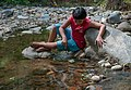 Boy playing in San Juan Bautista River.jpg