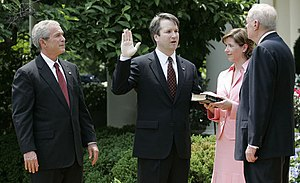 Brett Kavanaugh - Kavanaugh sworn in by Justice Kennedy as President Bush and Kavanaugh's wife, Ashley, look on.