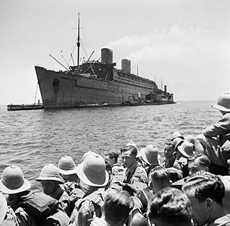 RMS Queen Elizabeth - Queen Elizabeth painted in wartime grey, having just transported troops to the Middle East in 1942