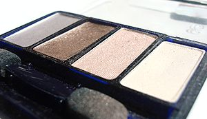Eye shadow - A powder eye shadow palette with brown shades for normal day wear; the two center colors are sparkly while the silver and white shades are for creating shadows and highlights.