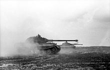 Three tanks moving across a field