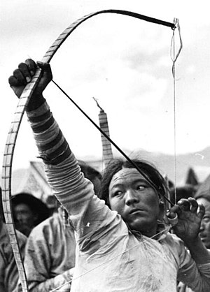 Thumb ring - Tibetan archer using a cylindrical thumb ring, 1938