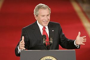 George W. Bush speaking at podium during press conference